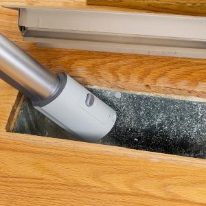 bigstock-Cleaning-Inside-Heating-Floor--51970165